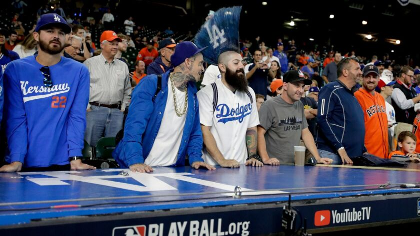 Fans watch batting practice before Game 5 of baseball's World Series between the Dodgers and the Astros in Houston.