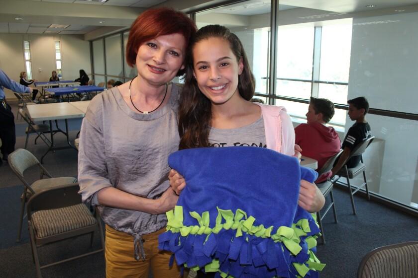 Tatiana Zunshine, executive director of Children Helping Children, and Bella Silberstein.