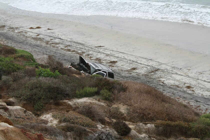 Junior Seau's  2004 Cadillac Escalade sits at the bottom of the Carlsbad cliff.