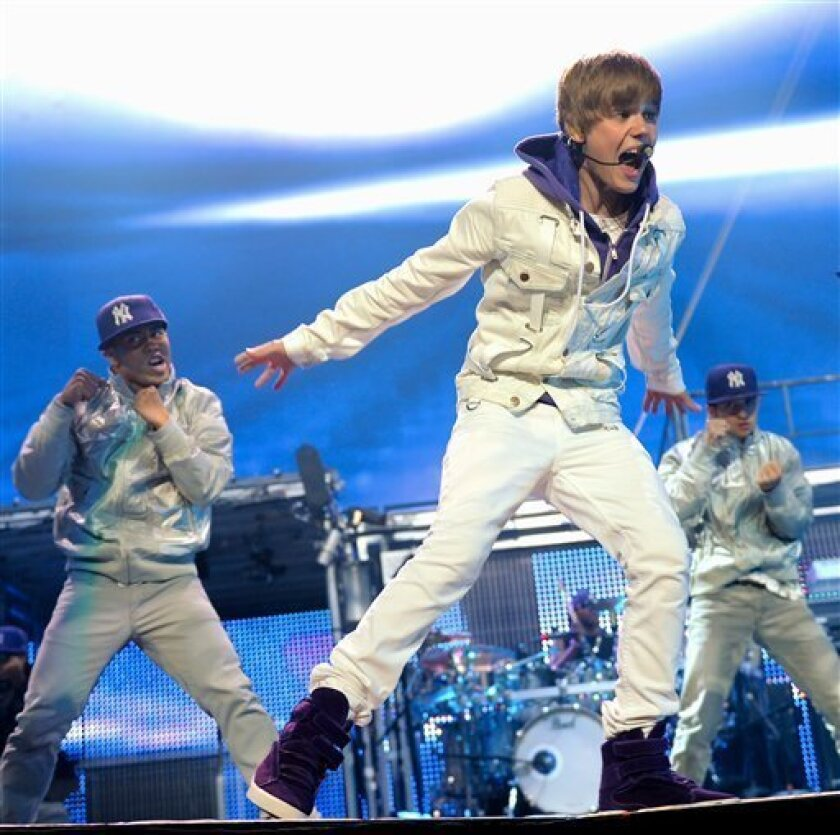 FILE - In this Aug. 31, 2010 file photo, singer Justin Bieber performs at Madison Square Garden in New York. (AP Photo/Evan Agostini, file)