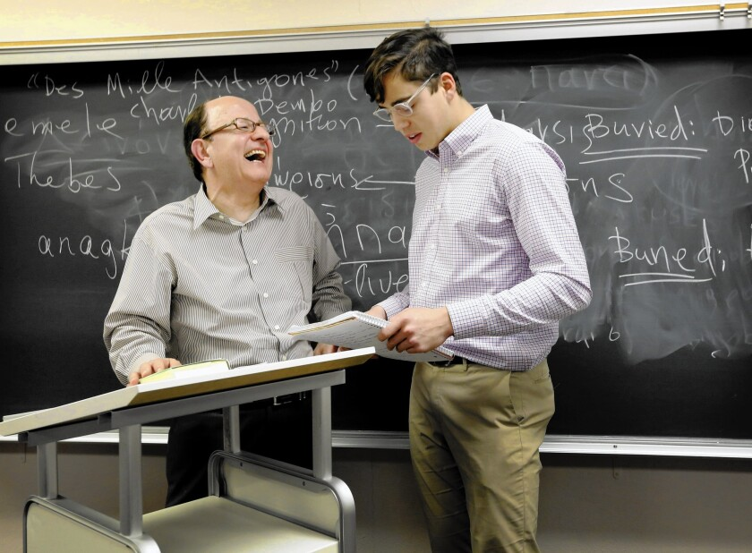 USC President C.L. Max Nikias, left, chatting with a student, is teaching a course on Greek culture this semester -- his first time in the classroom in years.