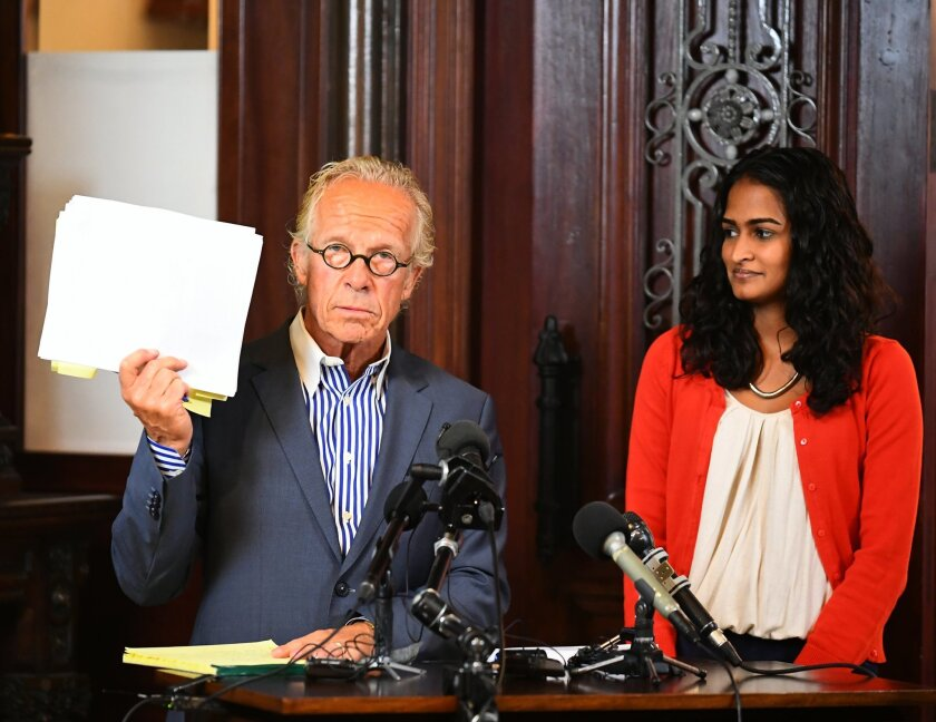 Attorney Jeff Anderson speaks during a news conference as Trusha Goffe, right, listens Wednesday, July 20, 2016, in St. Paul, Minn. Anderson, a prominent attorney for victims of clergy abuse, accused the Vatican of interfering in the investigation of a Minnesota archbishop during the news conferenc