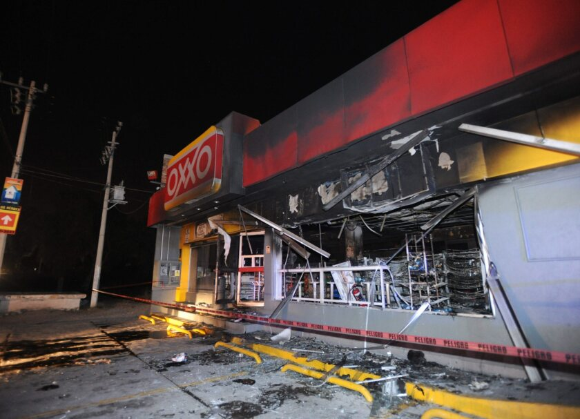 A picture made available Monday shows the aftermath of an attack on an Oxxo store, which was targeted Sunday by an armed group in Tizayuca, in Mexico's Hidalgo state.