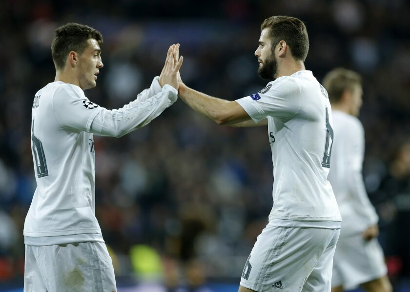 Real Madrid's Nacho Fernandez, right, the scorer of the game is congratulated by his teammate Mateo Kovacic after the Champions League group A soccer match between Real Madrid and PSG at the Santiago Bernabeu stadium in Madrid, Tuesday, Nov. 3, 2015. Real Madrid won 1-0. (AP Photo/Francisco Seco)