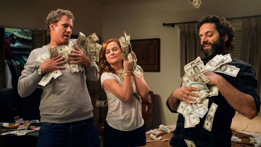 """Will Ferrell, left, Amy Poehler and Jason Mantzoukas in a scene from """"The House."""""""
