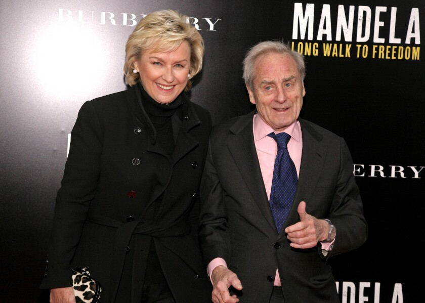 Tina Brown and husband Harold Evans on a red carpet in 2013.