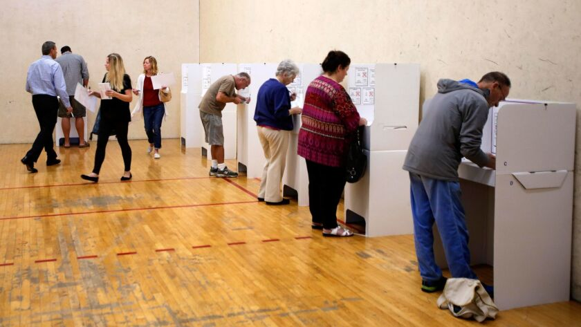 November 8, 2016 | Early morning voting was a full house at the polling place inside the Encinitas Boxing and Fitness Center in 2016's general election.