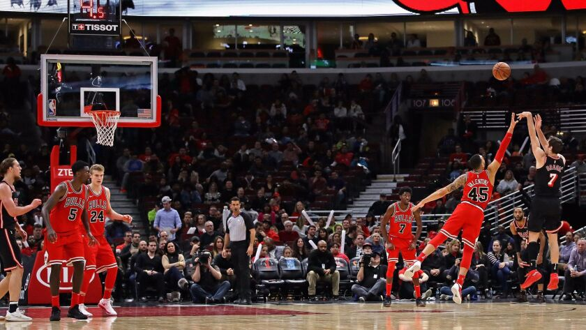 Goran Dragic of the Miami Heat puts up a three point shot over Denzel Valentine of the Chicago Bulls on his way to a team-high 24 points at the United Center.