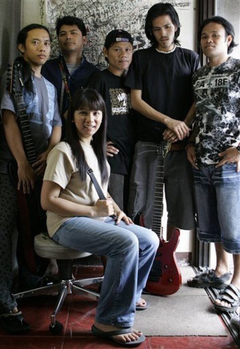 Sarah Balabagan, front, poses with bandmates at a studio in Quezon city, north of Manila, Philippines Dec. 5, 2008. Now a budding singer and TV host, Balabagan has come a long way since being freed from a 1995 death sentence she faced in the Middle East for killing an Arab employer she accused of a