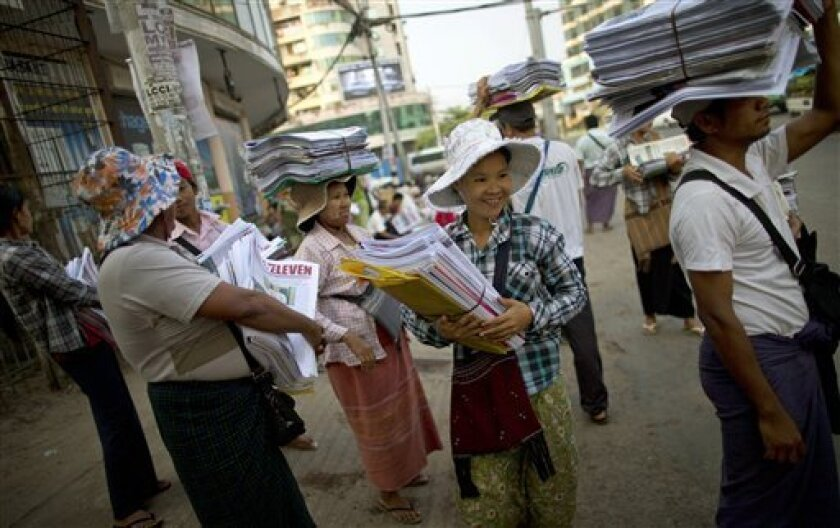 Newspaper sellers wait for a bus after receiving newspapers from a wholesale dispatcher in Yangon, Myanmar, Monday, April 1, 2013. For most people in Myanmar, it will be a novelty when privately run daily newspapers hit the streets on Monday. Many weren't even born when the late dictator Ne Win imp
