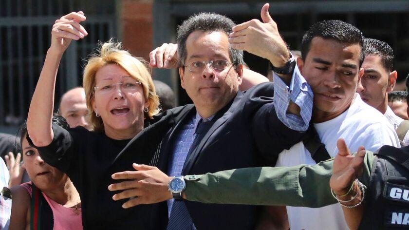 Venezuelan Atty. Gen. Luisa Ortega Diaz, left, was barred from entering her offices in Caracas on Aug. 5, 2017.