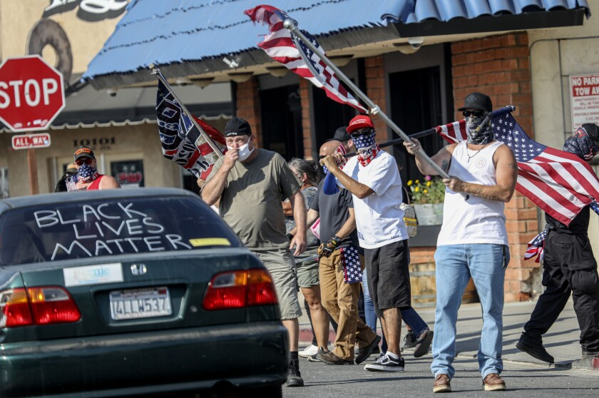 Pro-Trump supporters heckle BLM activists during a Caravan for Justice San Diego rally in Lakeside on Oct. 4.