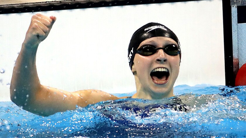 Katie Ledecky celebrates after winning the gold medal in the 400 freestyle.