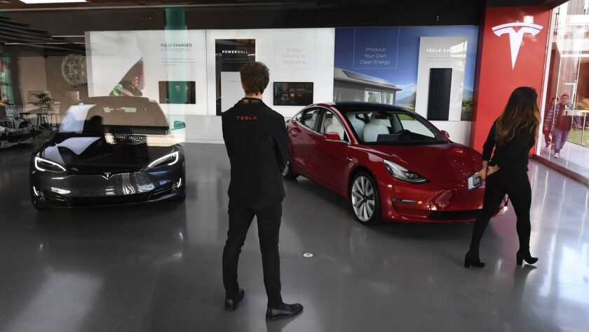 Tesla suggested bricks-and-mortar retail was important in its annual report filed nine days before Chief Executive Elon Musk announced a pivot to online sales. Above, a Tesla showroom.