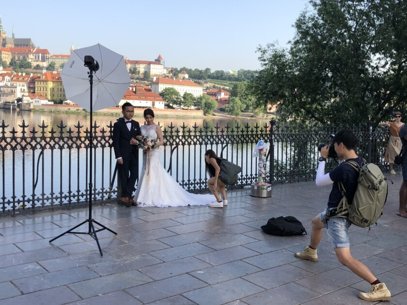 Tiffany Lau, a 30-year-old flight attendant from Hong Kong, poses with fiance Wayne Leung in Prague, Czech Republic.