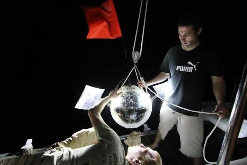 National Geographic Society Remote Imaging engineers Eric Berkenpas (bottom) and Graham Wilhelm prepare to deploy Dropcam.