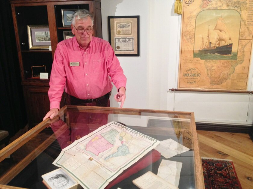 Map and Atlas Museum Director Richard Cloward shows a map of the gold regions of California, produced in 1849 by cartographers Ensign & Thayer.