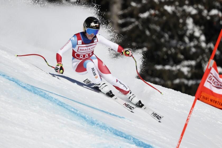 Switzerland's Lara Gut-Behrami speeds down the course during an alpine ski, women's World Cup super-G, in Crans Montana, Switzerland, Sunday, Jan. 24, 2021. (AP Photo/Gabriele Facciotti)