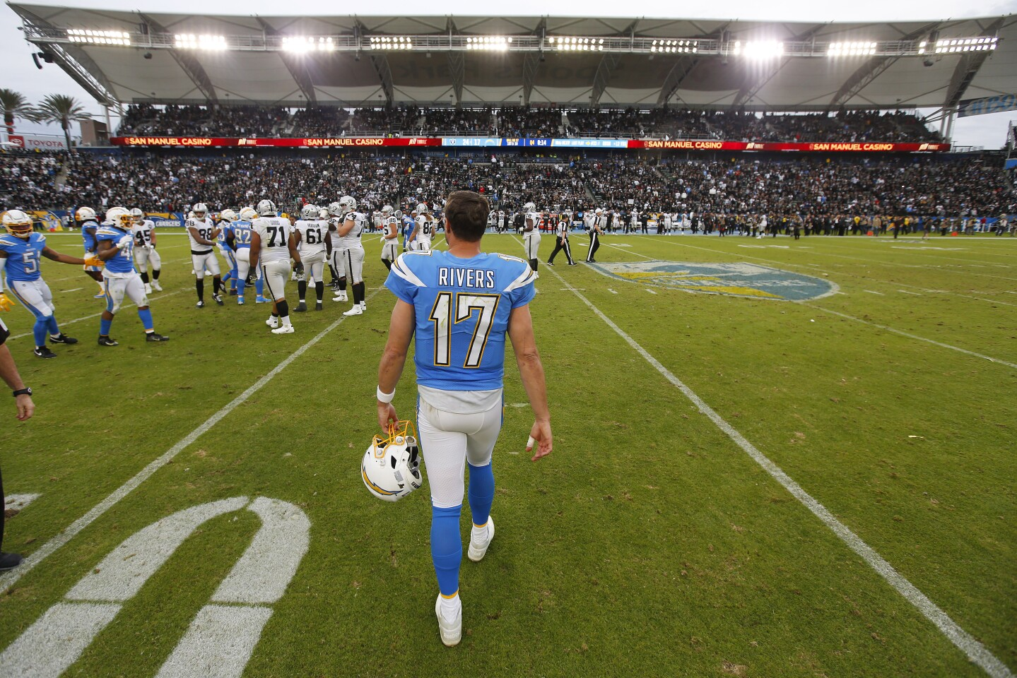 Los Angeles Chargers quarterback Philip Rivers walks off the field after a 24-17 loss to the Oakland Raiders in Carson on Dec. 22, 2019.