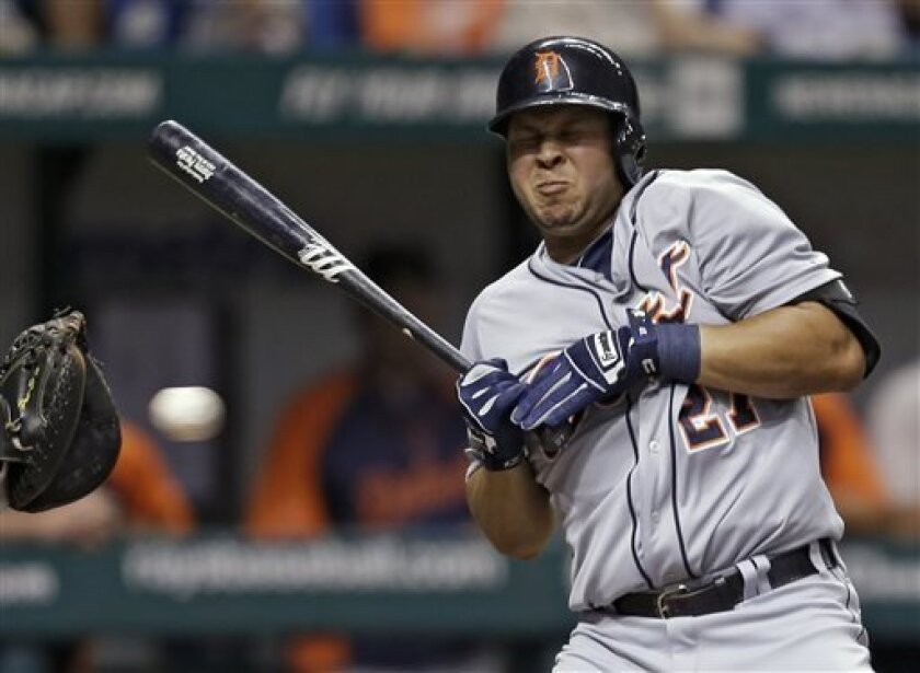 FILE - In this June 29, 2013 file photo, Detroit Tigers' Jhonny Peralta reacts as he ducks away from an inside pitch from Tampa Bay Rays starting pitcher Chris Archer during the third inning of a baseball game in St. Petersburg, Fla. Major League Baseball has told the union which players it intends to suspend in its drug investigation and which ones will receive lengthier penalties for their roles in the Biogenesis case. (AP Photo/Chris O'Meara, File)
