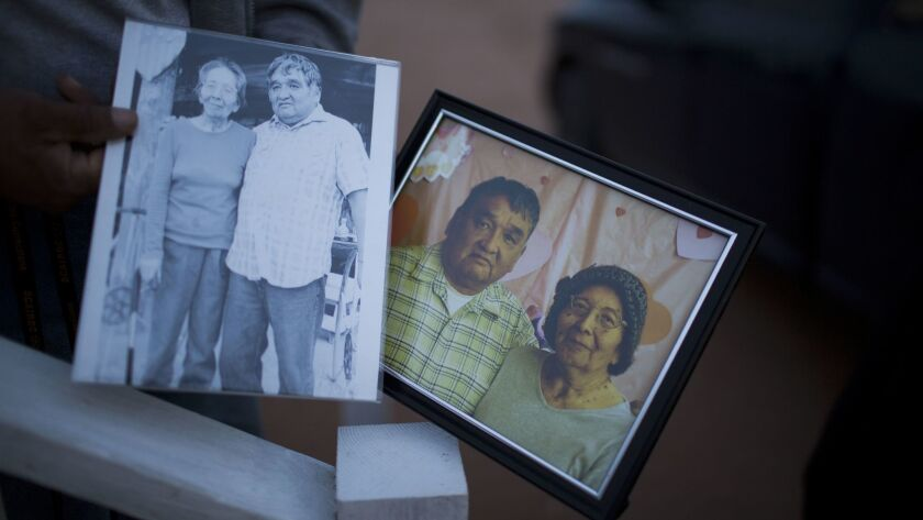 Mike Stevens shows photos of himself and his late wife, Lizette, who died of pancreatic cancer.