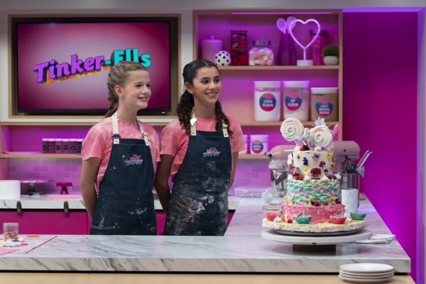 """From left, Ellie Joyce, 11, and Ella Traverso, 13 on the set of """"Disney's Magic Bake-Off."""""""