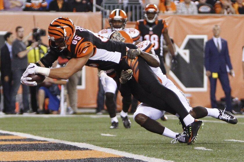 Cincinnati Bengals tight end Tyler Eifert (85) scores a touchdown against Cleveland Browns free safety Tashaun Gipson (39) during the first half of an NFL football game, Thursday, Nov. 5, 2015, in Cincinnati. (AP Photo/Frank Victores)
