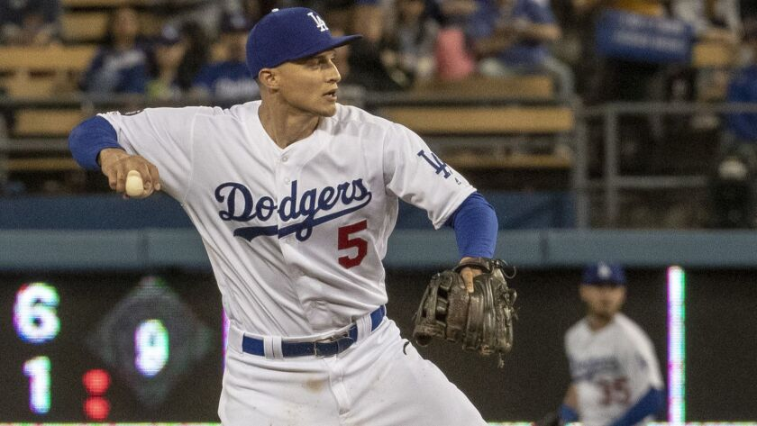 Corey Seager throws to first base during game against the Arizona Diamondbacks at Dodger Stadium on March 29.