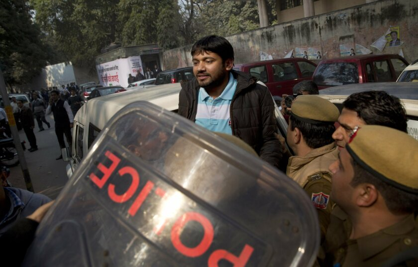 Kanhaiya Kumar, the president of the students' union at the country's premier Jawaharlal Nehru University is produced at a Delhi court, in New Delhi, India, Wednesday, Feb. 17, 2016. Dozens of lawyers, many with links to India's ruling nationalist party, clashed Wednesday with protesters demanding