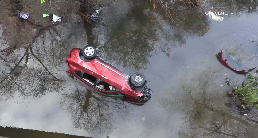 A driver was rescued from her car after it plunged off state Route 52 into the San Diego River early Wednesday.