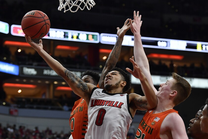 Louisville guard Lamarr Kimble (0) shoots between Miami guard Chris Lykes (0) and forward Sam Waardenburg (21) during the second half of an NCAA college basketball game in Louisville, Ky., Tuesday, Jan. 7, 2020. Louisville won 74-58. (AP Photo/Timothy D. Easley)