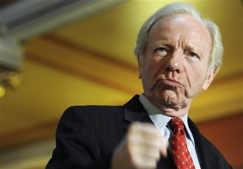 FILE - This Dec. 10, 2012 file photo, Sen. Joseph Lieberman, I-Conn. gestures during a news conference at the state capitol in Hartford, Conn. Retiring Sen. Joe Lieberman in his final Senate floor speech is urging Congress to put partisan rancor aside and reach across party lines to break Washington's gridlock. (AP Photo/Jessica Hill, File)