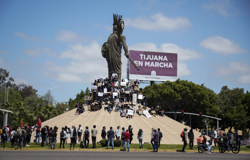 Protesters gather around the statue at the Cuauhtemoc roundabout