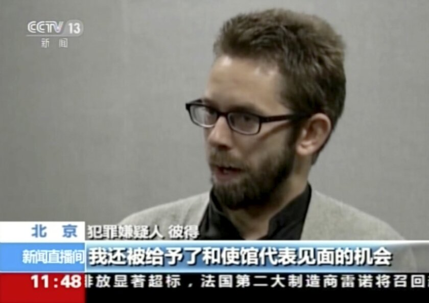 FILE - In this file image made from undated video released by China Central Television (CCTV), Peter Dahlin, a Swedish co-founder of a human rights group, speaks on camera in an unknown location. The Chinese government has released and deported the Swedish man it accused of training and funding unl