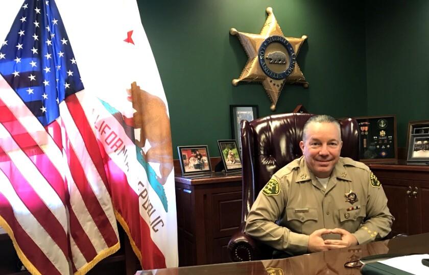L.A. County Sheriff Alex Villanueva poses for a portrait in his office.