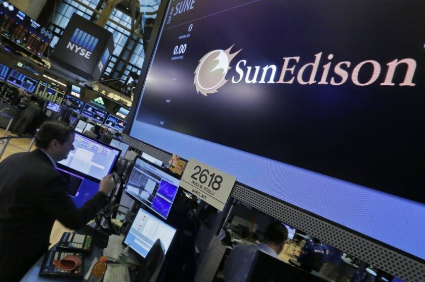 Specialist Gregg Maloney works at the SunEdison Inc. post on the floor of the New York Stock Exchange on March 8.