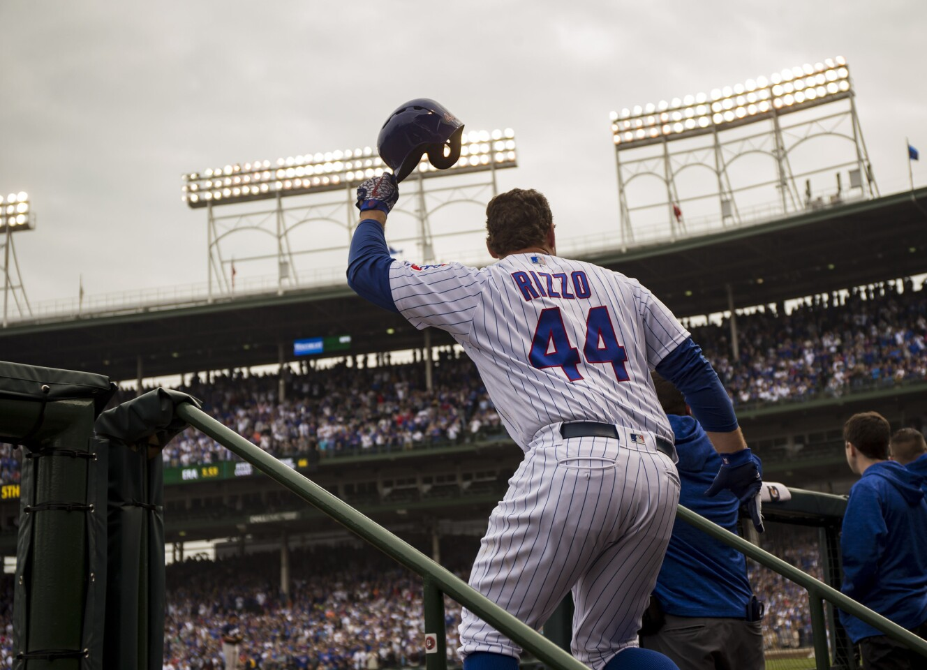 Chicago Cubs first baseman Anthony Rizzo (44) takes a curtain call after his home run in the fifth inning against the Milwaukee Brewers on Monday, Oct. 1, 2018 at Wrigley Field in Chicago, Ill.