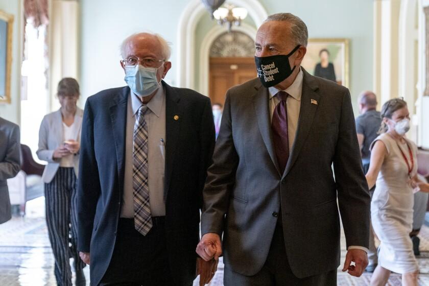 Sen. Bernie Sanders, I-Vt., left, and Senate Majority Leader Chuck Schumer of N.Y.