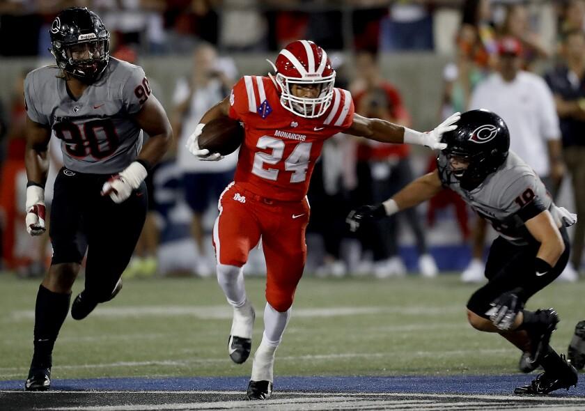 Mater Dei's Quincy Craig runs for a touchdown against Corona Centennial on Aug. 23, 2019.