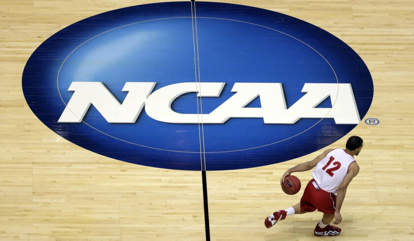 A federal judge ruled last week that NCAA policies toward college athletes violate antitrust law. Above, Wisconsin guard Traevon Jackson during the NCAA basketball tournament in Anaheim in March.