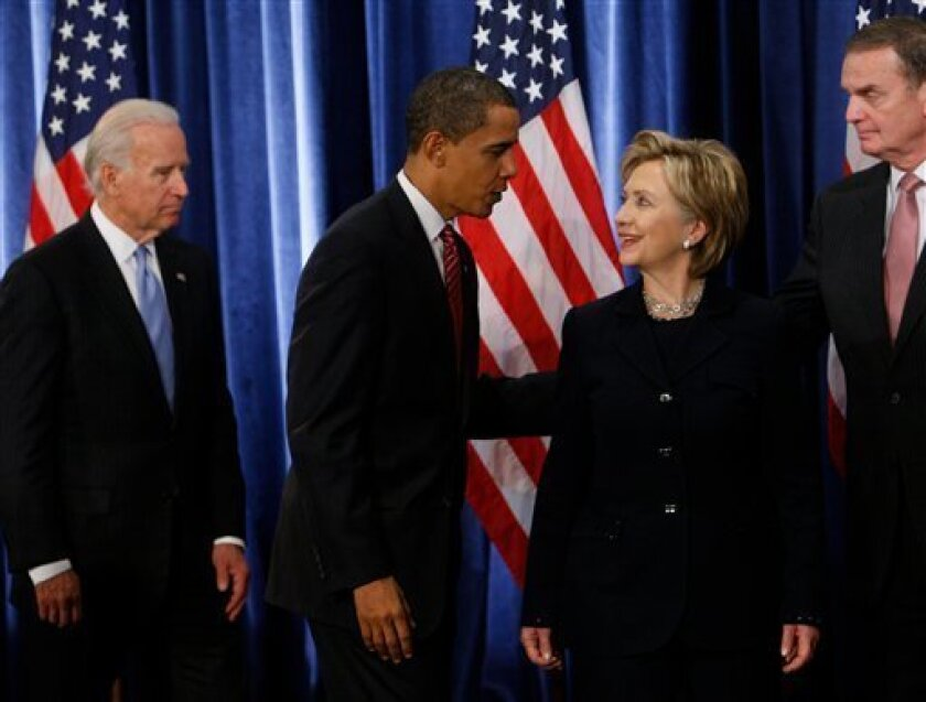 President-elect Barack Obama, second from left, stands with Secretary of State-designate Sen. Hillary Rodham Clinton, D-N.Y. third from left, as National Security Adviser-designate Ret. Marine Gen. James Jones, far right, and Vice President-elect Joe Biden, far left, leave the stage at the end of a news conference in Chicago, Monday, Dec. 1, 2008. (AP Photo/Charles Dharapak)