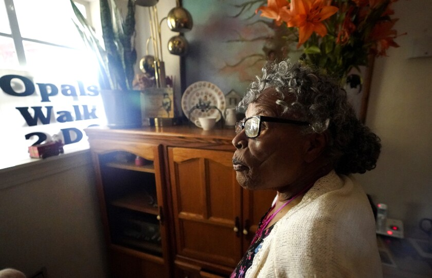 Opal Lee pauses as she gives a tour of her home Thursday, July 1, 2021, in Fort Worth, Texas. Opal Lee's dream of seeing Juneteenth become a federal holiday was finally realized over the summer, but the energetic woman who spent years rallying people to join her push for the day commemorating the end of slavery is hardly letting up on a lifetime of work teaching and helping others.(AP Photo/LM Otero)