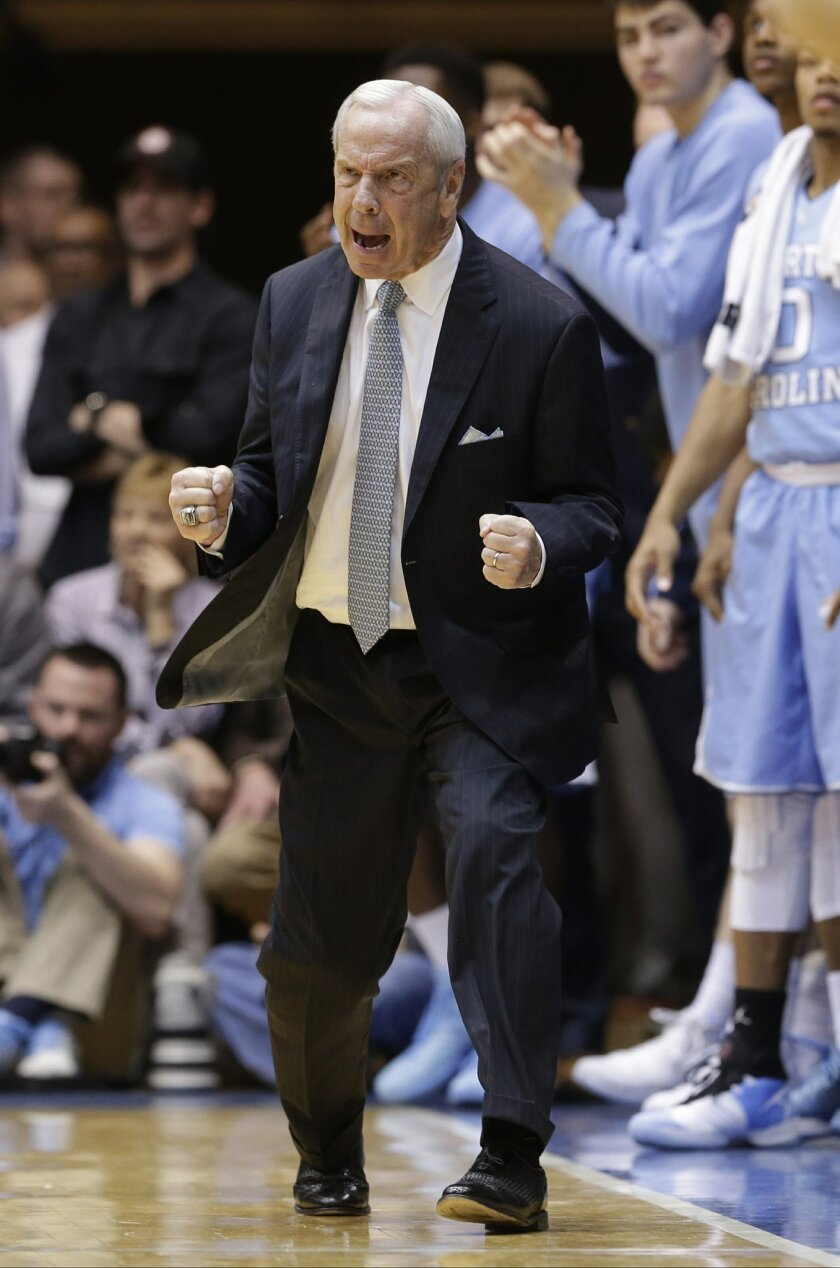 FILE - In this March 5, 2016, file photo, North Carolina head coach Roy Williams reacts against Duke during the second half of an NCAA college basketball game in Durham, N.C. Williams had knee replacement surgery on his right knee on Friday, May 27, 2016. An athletics spokesman says in an email tha