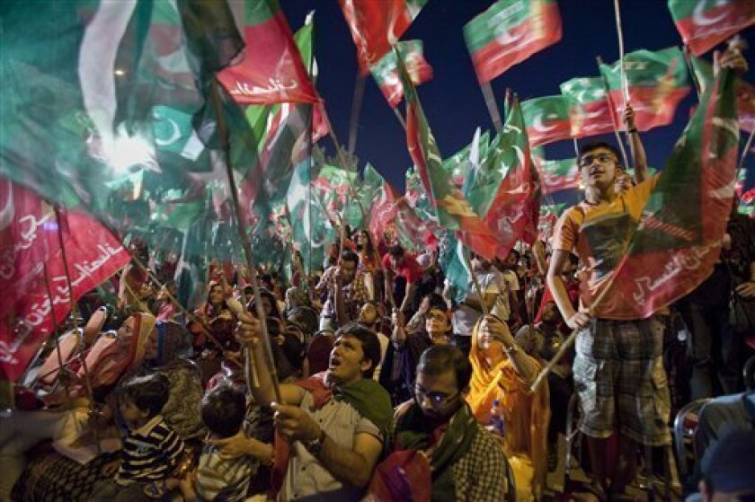 Supporters of Pakistan Tehreek-e-Insaf or Moment for Justice party attend an election campaign rally in Islamabad, Pakistan, Thursday, May 9, 2013. Pakistan is scheduled to hold parliamentary elections on May 11, the first transition between democratically elected governments in a country that has experienced three military coups and constant political instability since its creation in 1947. The parliament's ability to complete its five-year term has been hailed as a significant achievement. (AP