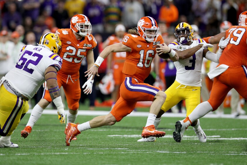 Clemson's quarterback Trevor Lawrence runs the ball against LSU during the first half in the college football championship game on Monday in New Orleans.