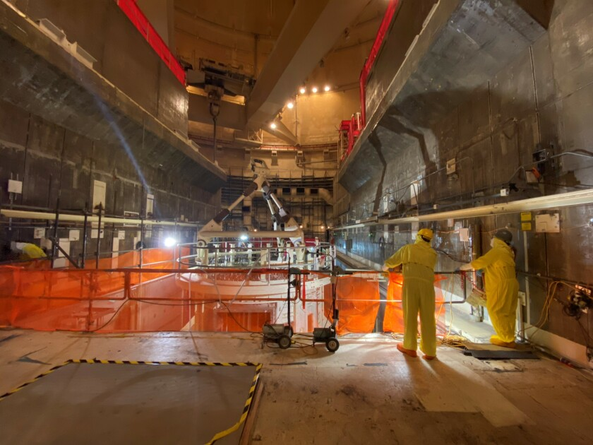 Crews at the San Onofre Nuclear Generating Station work on dismantlement efforts inside Unit 2.