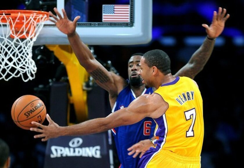 Xavier Henry slips a pass behind DeAndre Jordan during the Lakers' 116-103 home-opening win over the Clippers.