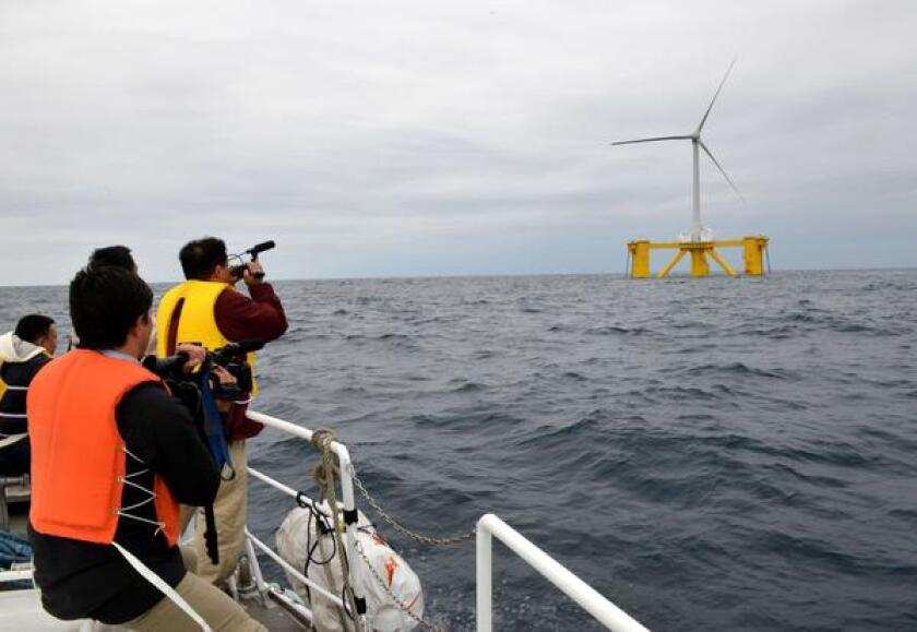 Japanese government and industry leaders inaugurated the country's first floating wind turbine and substation Monday, about 13 miles offshore from the crippled Fukushima Daiichi nuclear complex. Officials hope to expand renewable resources and reduce or phase out nuclear power generation.