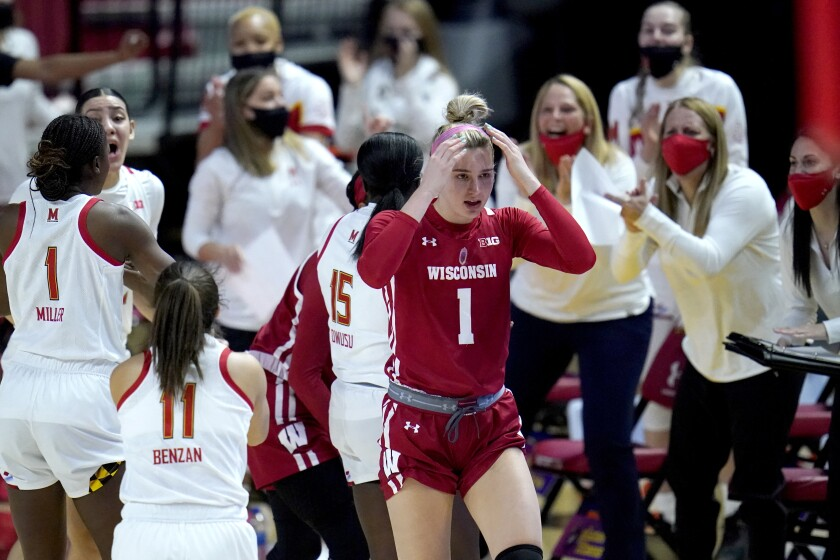 Wisconsin guard Estella Moschkau, center, reacts after being called for a violation against Maryland during the first half of an NCAA college basketball game, Thursday, Feb. 4, 2021, in College Park, Md. (AP Photo/Julio Cortez)