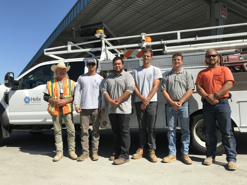 Helix Water District and Padre Dam Municipal Water District field employees are heading to Paradise in northern California for a week to help that city rebuild their water system in the wake of last November's devastating Camp Fire. Pictured from left to right: Helix employees John Wilson, Eric Hughes, Dan Baker and Bryan Watte, and Padre Dam workers Jesse Knowles and Austin Darley.
